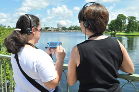 Mother and son Guests exploring the outdoors with handheld device
